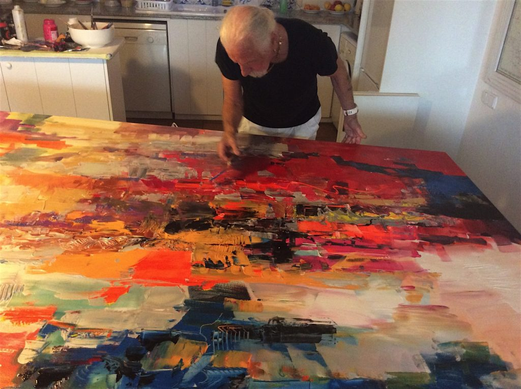 working-on-abstract-painting-acrylic-on-canvas
